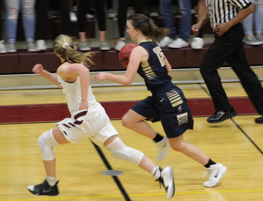 Emma Keaser, 12th grade, races across the court.