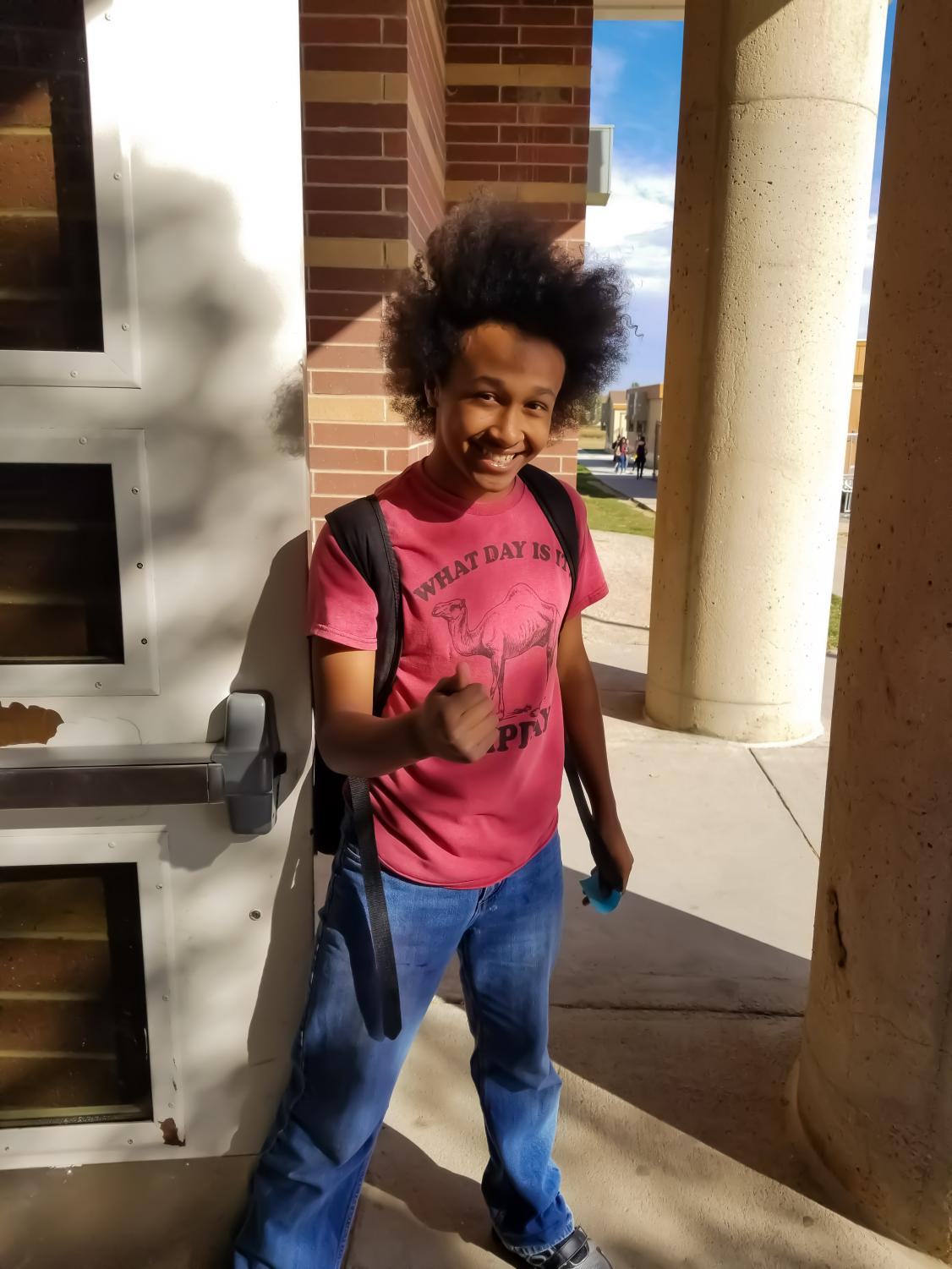 """Noah Olson gives his signature smile and fistbump at the east doors just before 5th period. He says that""""It's always nice just for people to do that [random acts of kindness] in general."""""""