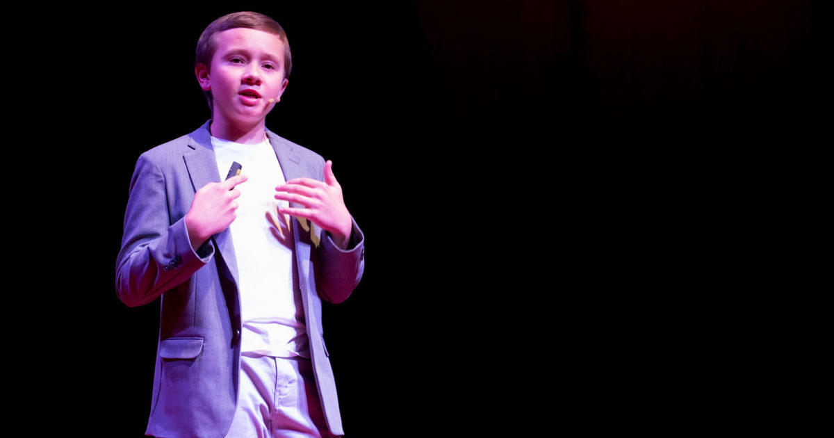 """Jack Bonneau giving a speech for the youth of today saying that they should look at other kids as their own role models at the 2018 Spring TEDxBoulder event. """"There are so many kids that we can look up to. To see ourselves in their shoes. Their journey to inspire us to embark on our own journey, our own path. We can see ourselves in them because they are just like us."""" Image and quote courtesy of TEDxBoulder"""